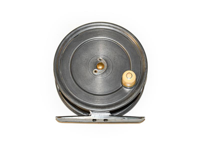 A Hardy Uniqua 4 1/2'' Salmon Fly Reel with horseshoe latch, ivorine handle and full length brass