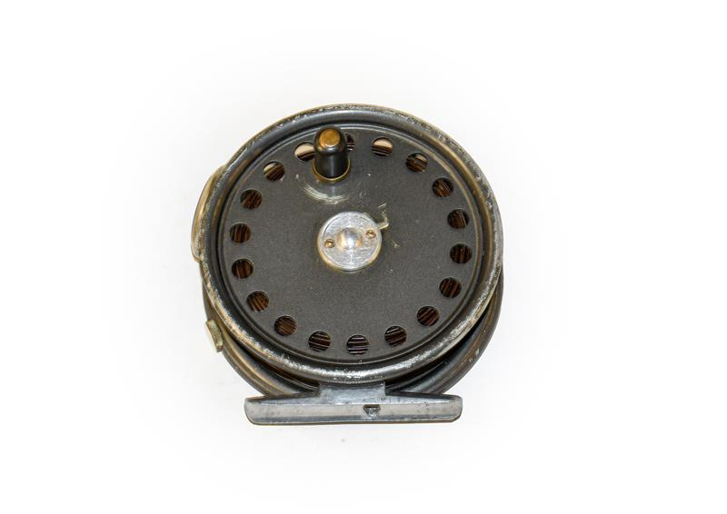 A Hardy St George 3 3/8'' Fly Reel with agate line guard and 2 screw latch.