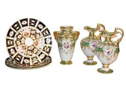 A garniture of Noritake ewers and vase and together with three Royal Crown Derby Imari plates .