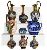 ~ Doulton pottery comprising a pair of Royal Doulton ewers (a.f.), a Doulton Lambeth vase and Slater