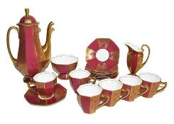 ~A 1930s Royal Doulton coffee service with gilt decoration on a red ground comprising a coffee