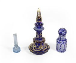 Three Glass Scent-Bottles, comprising: a gilt-heightened blue glass example, 19.5cm high; a cased