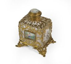 A French Brass-Mounted Clear Glass Scent-Bottle, oblong, with openwork brass mounts, the front