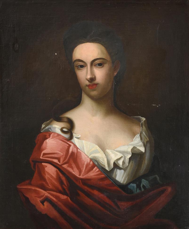 Follower of Michael Dahl (1659-1743) Swedish Portrait of a lady, half length, wearing a red satin