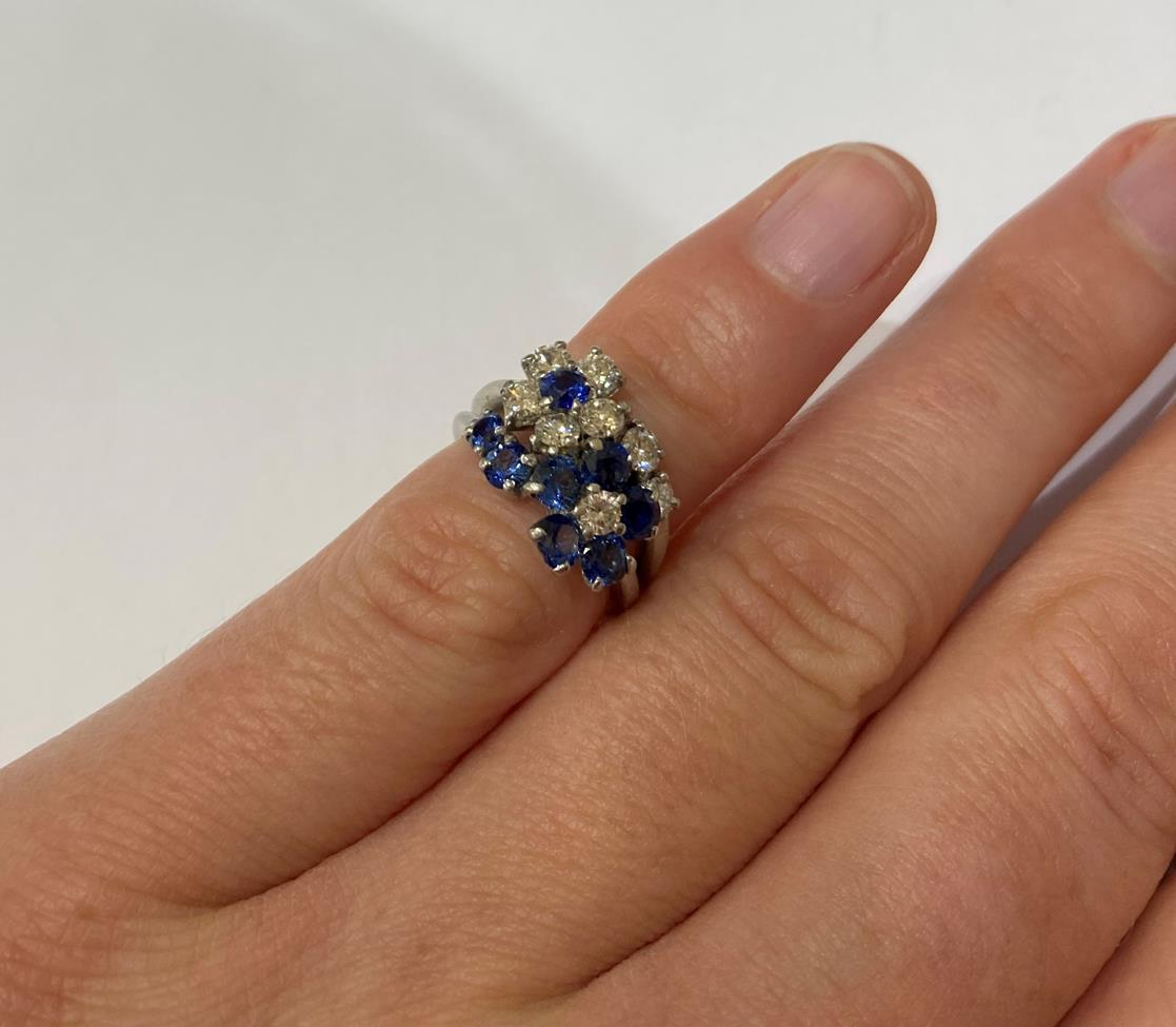 A Sapphire and Diamond Cluster Ring, realistically modelled as two floral motifs, one cluster formed - Image 6 of 6