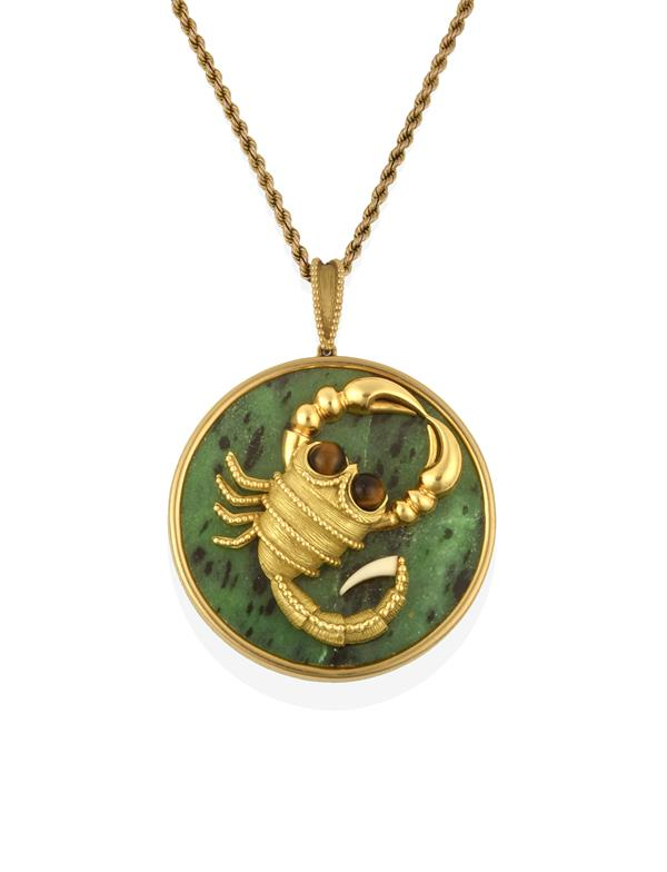 A French Quartz Tiger's-Eye and Green Plaque Pendant on Chain, the circular green plaque applied