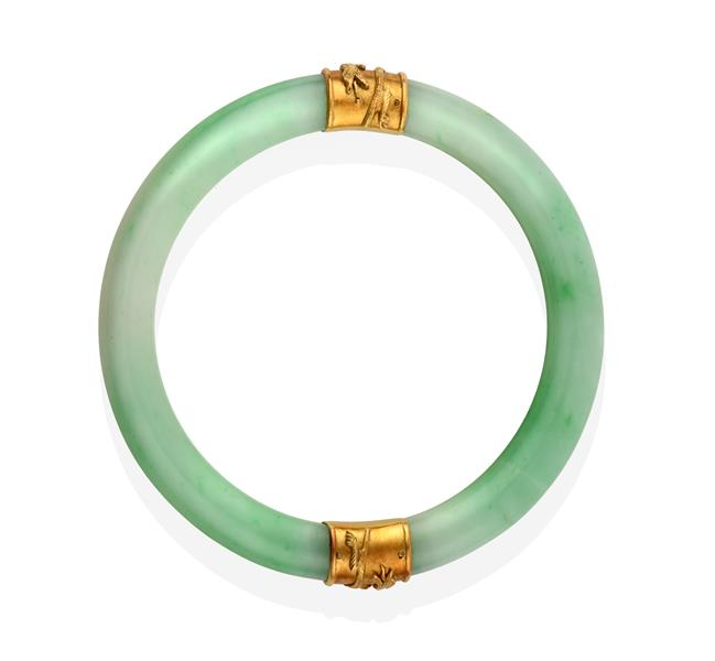 A Jade Bangle, with two bands overlaid with dragon detailing, measures 7.1cm inner diameter . The