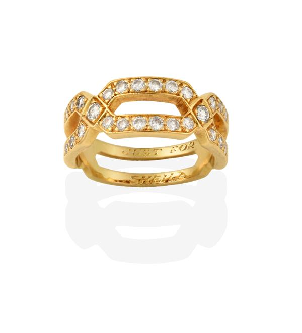 A Diamond Ring, realistically modelled as a split buckle, set throughout with round brilliant cut