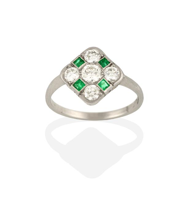 An Art Deco Style Emerald and Diamond Ring, the round brilliant cut diamond within a border of