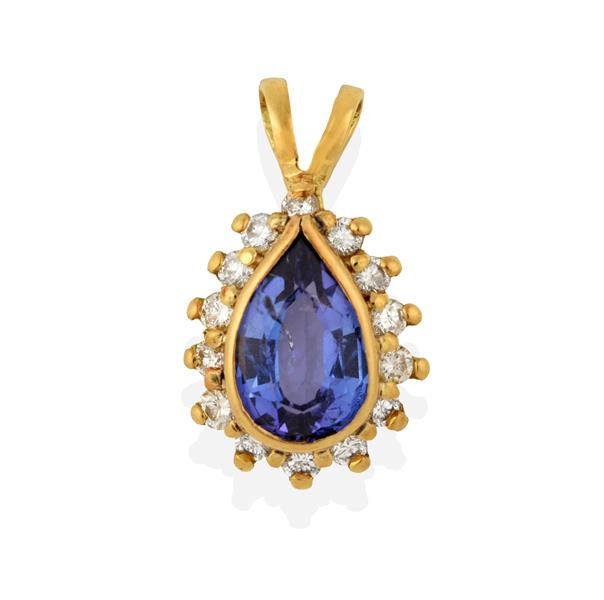 A Tanzanite and Diamond Cluster Pendant, the pear shaped tanzanite in a yellow rubbed over