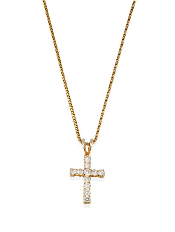 An 18 Carat Gold Diamond Cross Pendant on Chain, the cross motif formed of round brilliant cut
