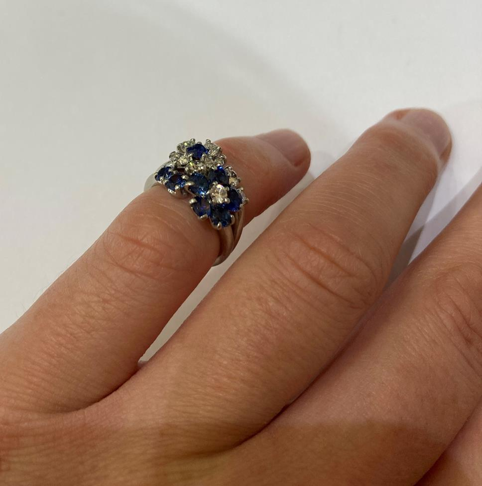 A Sapphire and Diamond Cluster Ring, realistically modelled as two floral motifs, one cluster formed - Image 5 of 6