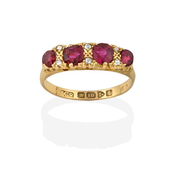 An 18 Carat Gold Ruby and Diamond Ring, four graduated round cut rubies spaced by rose cut diamond