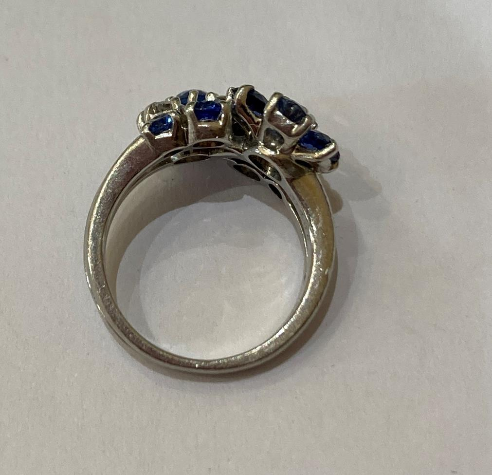 A Sapphire and Diamond Cluster Ring, realistically modelled as two floral motifs, one cluster formed - Image 4 of 6