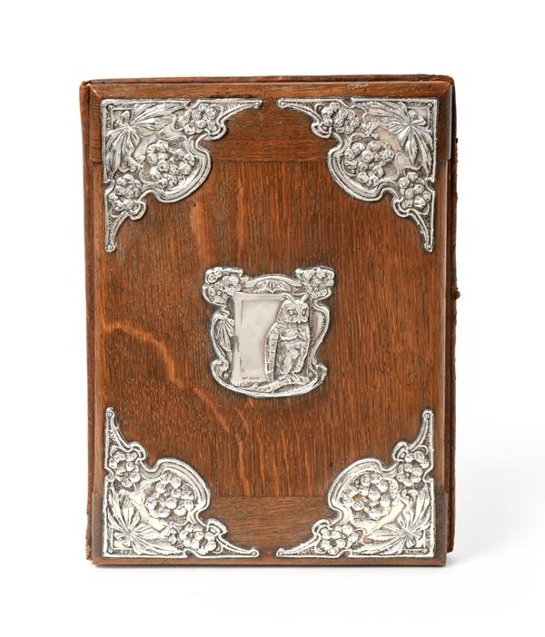 An Edward VII Silver-Mounted Oak Desk-Blotter, by J. Aitkin and Son, Birmingham, 1905, oblong, the