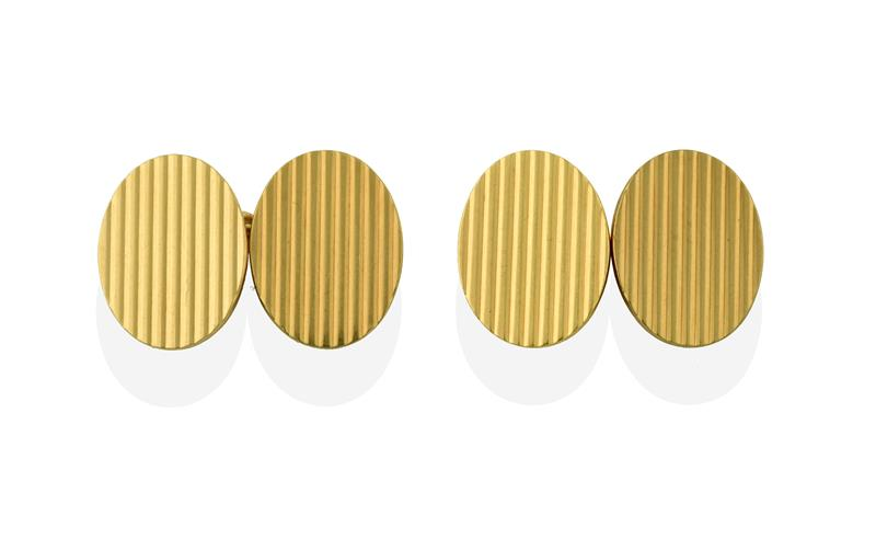 A Pair of 18 Carat Gold Cufflinks, the chain linked oval plaques of ridged design, cased by Armour