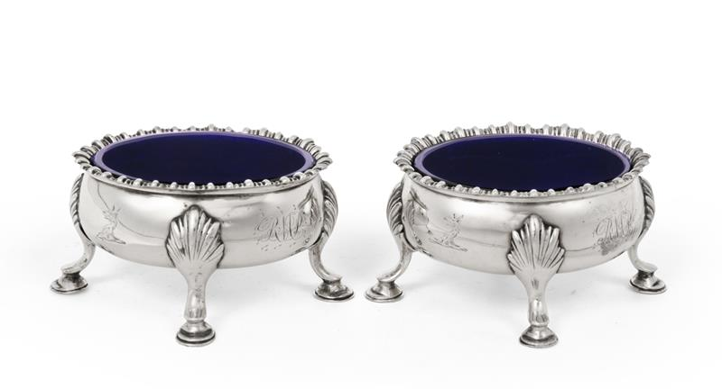 A Pair of George III Silver Salt-Cellars, by David and Robert Hennell, London, 1766, each bombé oval