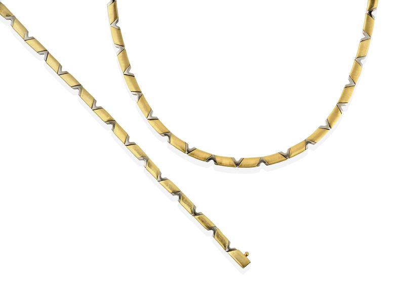 A Fancy Link Necklace, articulated polished yellow rhomboids spaced by polished white V-shaped