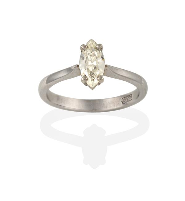 A Diamond Solitaire Ring, the marquise cut diamond in a white claw setting, to a tapered shoulder