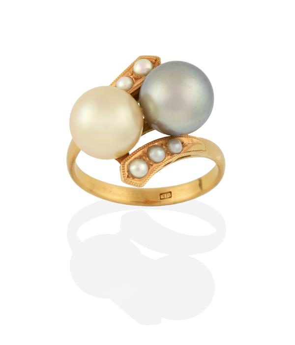 A Cultured Pearl Twist Ring, two cultured pearls diagonally set, to split pearl set twist shoulders,