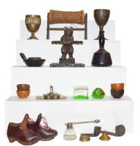 Two trays of metal wares and wooden items including a Black Forest pipe rack, Nailsea glass pipe and