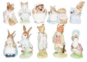 Beswick Beatrix Potter figures including: 'Hunca Munca', 'Foxy Whiskered Gentleman', and 'Tom