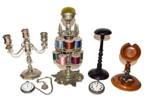 Metal two tier bobbin stand, plated candelabrum, ebonised wig stand, combined watch stand and pin