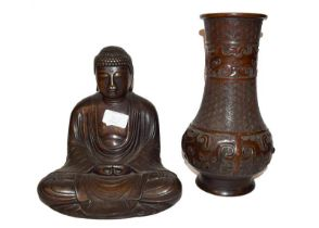 A Chinese bronze statue of a seated Buddha, together with a Japanese bronze vase after a Chinese