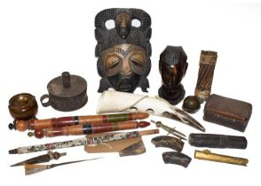 A tray of tribal carved souvenir items including a mask and various figures, together with treen and