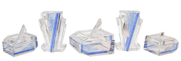 A part Art Deco cut glass and blue stained dressing table set, comprising a pair of candlesticks and