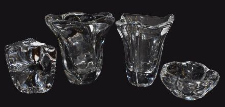 Four pieces of modern Daum clear crystal glass, comprising two vases, an abstract candle holder