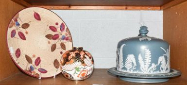 A Jasper ware cheese dome, Charlotte Rhead for Crown ducal charger, and a Royal Crown Derby vase (3)