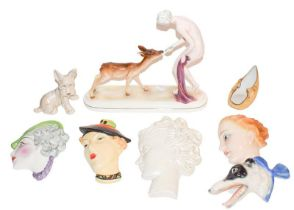 Assorted English and European 1930's and later face mask plaques, figure of girl and doe etc (two