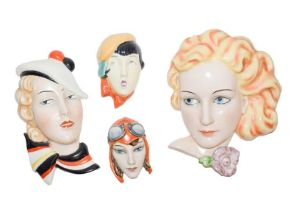 Goebels deco wall mask of a blonde girl, a Czech smaller mask of girl with striped scarf, a