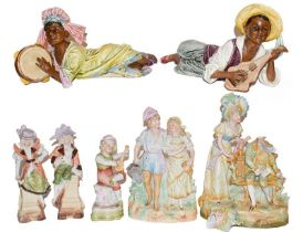 A pair of Goldschieder style figures of reclining Caribbean musicians (a.f.); together with a