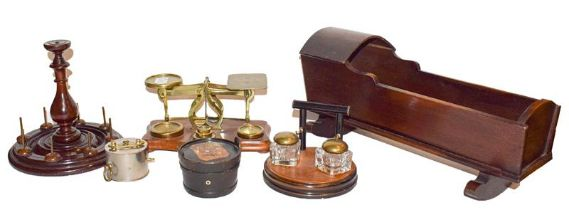 Dolls cradle, set of brass mounted postal scales and weights, cotton reel stand, ebonised inkstand