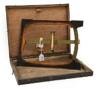 Clinometer showing inclination in inches per foot on brass scale, with level on arm in rectangular
