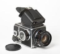 Hasselblad 500C/M Camera no.UR1214518 with Carl Zeiss T* Planar f2.80mm lens, prism viewer and