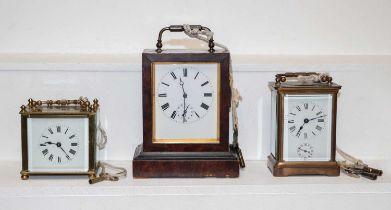 A VAP alarm carriage timepiece, brass alarm carriage timepiece and another brass timepiece (3)