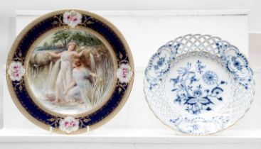 A 19th century Vienna porcelain cabinet plate, together with a Meissen blue and white plate in the