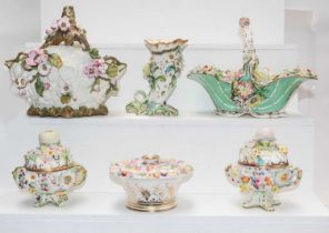 A quantity of early 19th century English porcelain encrusted with flowers, to include