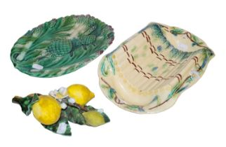 Two 19th century Continental Majolica dishes moulded with artichokes, and a Majolica still life