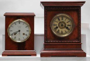 A German striking mantel clock retailed by Woodford, another German striking mantel clock, an Art