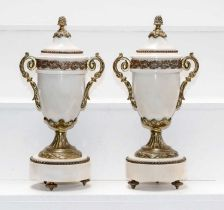 A pair of early 20th century white marble and gilt metal mounted garniture urns