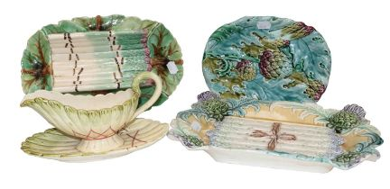 A collection of 19th century Continental Majolica moulded with asparagus and artichokes, including a