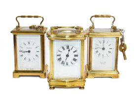 A brass carriage timepiece, circa 1900 and two other carriage timepieces, 20th century (3)