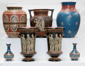 A quantity of Mettlach pottery including a garniture of three vases incised with Grecian figures,