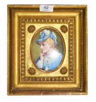 An early 20th century watercolour portrait miniature depicting a lady in blue, and in gilt frame