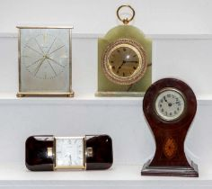 A brass cased mantel timepiece signed Garrard, a faux tortoiseshell purse style travelling timepiece