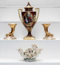 A Vienna twin-handled vase painted with figures, a Meissen style candelabra, and other Continental